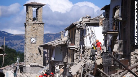 Firemen and rescuers inspect damaged buildings  in Amatrice on August 24, 2016 after a powerful earthquake rocked central Italy.  The earthquake left 38 people dead and the total is likely to rise, the country's civil protection unit said in the first official death toll. Scores of buildings were reduced to dusty piles of masonry in communities close to the epicentre of the pre-dawn quake in a remote area straddling the regions of Umbria, Marche and Lazio. / AFP PHOTO / FILIPPO MONTEFORTEFILIPPO MONTEFORTE/AFP/Getty Images