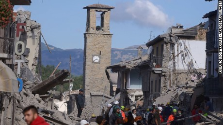 Rescuers and firemen inspect the rubble of buildings  in Amatrice on August 24, 2016 after a powerful earthquake rocked central Italy. The earthquake left 38 people dead and the total is likely to rise, the country's civil protection unit said in the first official death toll. Scores of buildings were reduced to dusty piles of masonry in communities close to the epicentre of the pre-dawn quake in a remote area straddling the regions of Umbria, Marche and Lazio. / AFP PHOTO / FILIPPO MONTEFORTEFILIPPO MONTEFORTE/AFP/Getty Images