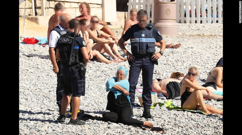 This photo of a woman being confronted by police on a beach in Nice caused international outrage