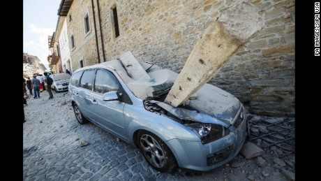 A stone beam landed on top of a car in Amatrice, Italy during the earthquake