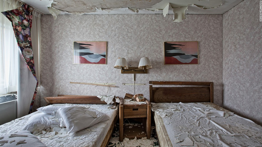 When it opened in 1957, the Fallside Inn had a pool, tennis courts, hot tubs, a conference center and ballroom. Today, peeling paint falls on the floor of its rooms. The retro telephone and wall hangings give an indication of its age.