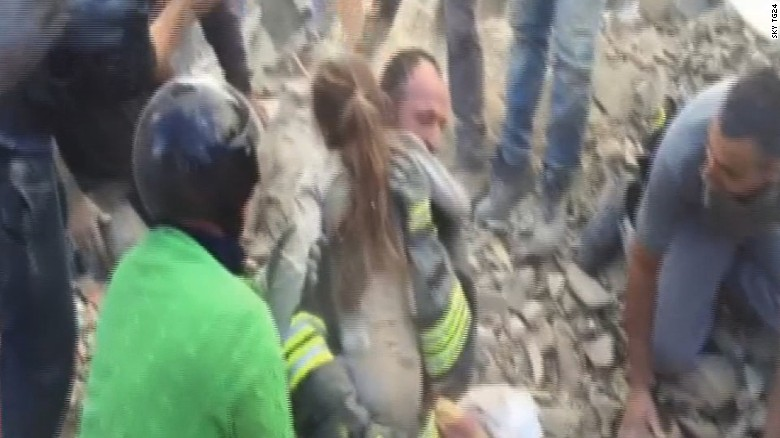 An 8-year-old girl is rescued from the debris of a collapsed building in Pescara del Tronto.