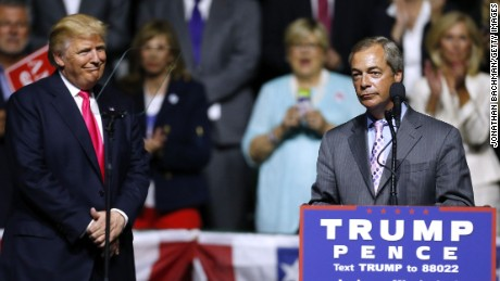 Republican Presidential nominee Donald Trump, left,  listens to United Kingdom Independence Party leader Nigel Farage speak during a campaign rally at the Mississippi Coliseum on August 24, 2016 in Jackson, Mississippi.