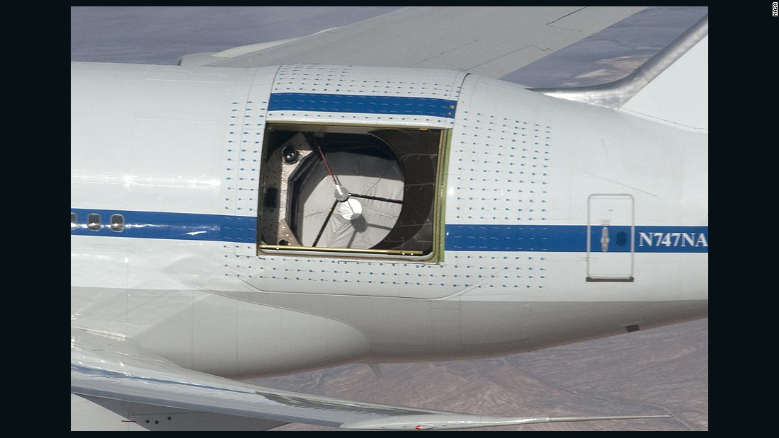 At 35,000 feet, a custom door opens on SOFIA's left side, revealing the telescope in an unpressurized part of the aircraft. All airplane observatories position their telescopes on left side, said flight planner Allan W. Meyer. Flying observatories get more data that way because they can slow down the rising and setting of objects by heading in that direction.