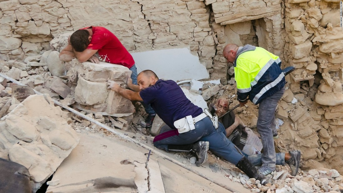"""A man, in red, cries as his friend is pulled from the rubble after a 6.2-magnitude earthquake in Amatrice, Italy, on Wednesday, August 24. The earthquake -- which killed at least 250 people and injured more than 360 -- devastated towns across central Italy, leaving rescuers on a <a href=""""http://www.cnn.com/2016/08/25/europe/italy-earthquake/"""" target=""""_blank"""">desperate search for survivors</a>."""