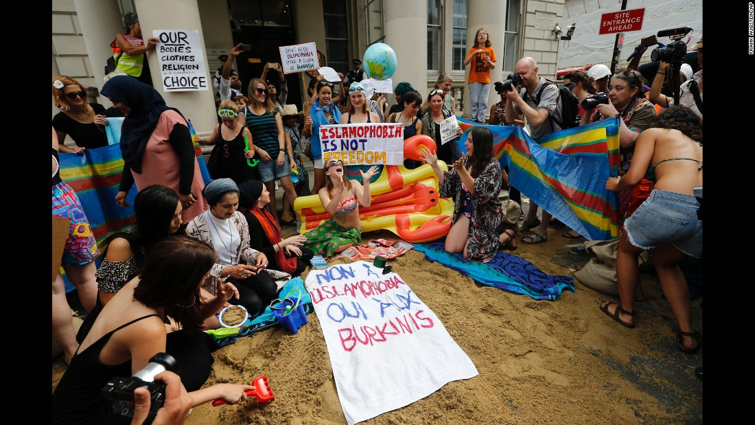 """People protest outside the French Embassy in London on Thursday, August 25, in response to some French authorities' decision to <a href=""""http://www.cnn.com/2016/08/24/europe/woman-burkini-nice-beach-incident-trnd/"""" target=""""_blank"""">ban women from wearing burkinis on the beach</a>. The French Council of State <a href=""""http://edition.cnn.com/2016/08/26/europe/france-burkini-ban-court-ruling/index.html"""" target=""""_blank"""">suspended the ban</a> on Friday, August 26, ruling that French mayors do not have the right to ban burkinis -- swimsuits that cover the whole body except for the face, hands and feet."""