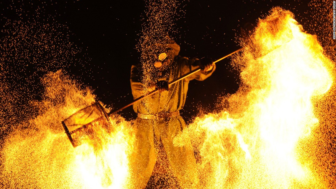 A fire artist performs during the Minsk International Fire Fest in Ratomka, Belarus, on Friday, August 19.