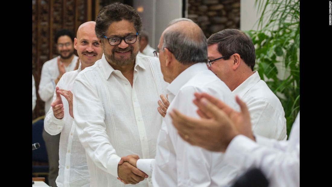 """Ivan Marquez, left, shakes hands with Humberto de la Calle in Havana, Cuba, on Wednesday, August 24. Marquez, the commander of the Marxist rebel group FARC, and de la Calle, Colombia's chief negotiator, were together after <a href=""""http://www.cnn.com/2016/08/25/americas/colombia-farc-peace-deal-explainer/"""" target=""""_blank"""">reaching a final peace deal</a> in one of the world's longest-running conflicts."""
