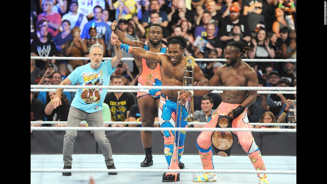 Jon Stewart, left, joins wrestlers Big E, Xavier Woods and Kofi Kingston in the ring at WWE SummerSlam at the Barclays Center in New York on Sunday, August 21.