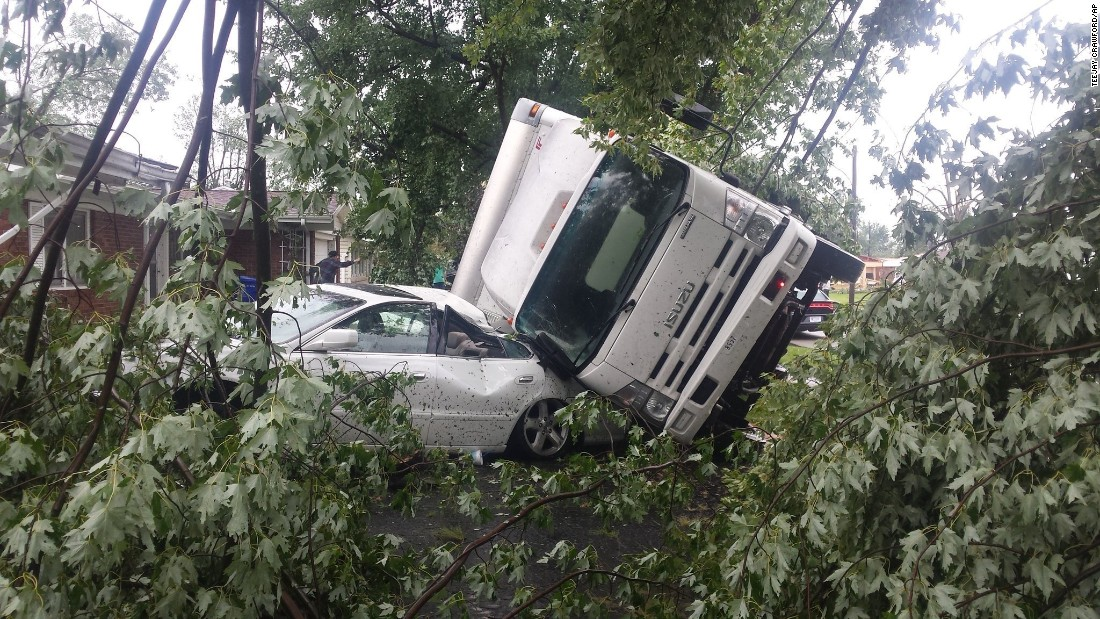 """Two vehicles are badly damaged after a tornado in Kokomo, Indiana, on Wednesday, August 24. Between 15 and 20 people were injured after <a href=""""http://www.cnn.com/2016/08/24/us/indiana-tornadoes/"""" target=""""_blank"""">three tornadoes struck the city</a> on Wednesday, and multiple structures, including a Starbucks, were destroyed."""