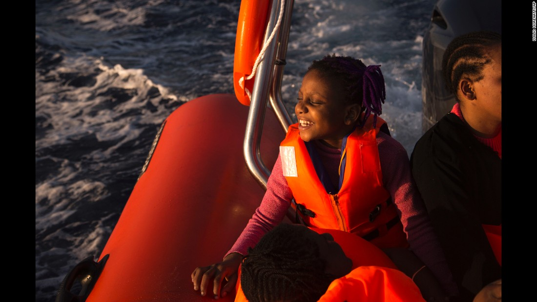 Sira, a 9-year-old Nigerian girl, smiles after being rescued by the nongovernmental organization Proactiva Open Arms in an operation in the Mediterranean Sea about 17 miles north of Sabratha, Libya, on Saturday, August 20.