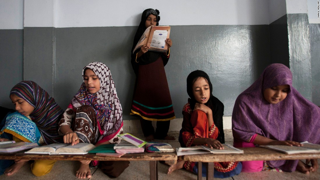 Girls recite verses of the Quran, the holy book of Islam, at a seminary in Karachi, Pakistan, on Saturday, August 20.