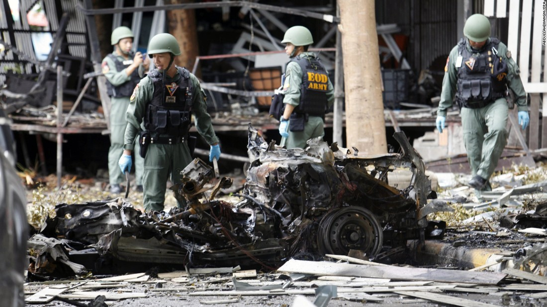 """Members of the Thai Explosive Ordnance Disposal Squad inspect vehicles after a car bomb attack at a hotel in Pattani, Thailand, on Wednesday, August 24. <a href=""""http://www.reuters.com/article/us-thailand-security-blast-idUSKCN10Y2H6"""" target=""""_blank"""">According to Reuters</a>, one person was killed and 30 were wounded after two explosions."""