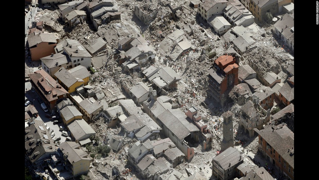"""An aerial view of Amatrice, Italy, shows the devastation from a <a href=""""http://www.cnn.com/2016/08/24/europe/italy-earthquake-towns/"""" target=""""_blank"""">6.2-magnitude earthquake</a> on Wednesday, August 24. The earthquake struck just days ahead of the city's """"Festival of the Spaghetti all'Amatriciana."""""""