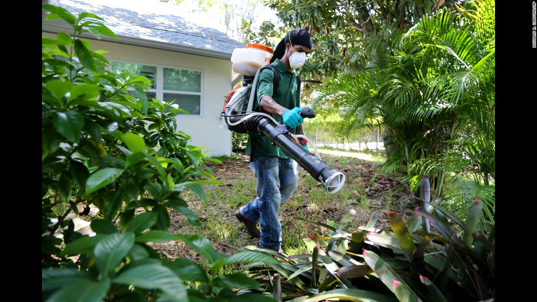 """Aaron Anderson sprays anti-mosquito insecticide behind a home in Oldsmar, Florida, on Tuesday, August 23. Mosquito-control workers have been <a href=""""http://www.cnn.com/videos/health/2016/08/25/naled-spraying-miami-zika-cohen-dnt.cnn"""" target=""""_blank"""">trying to combat the growing Zika virus threat</a>."""