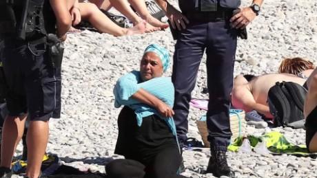 burkini ban protest mclaughlin pkg_00000725.jpg
