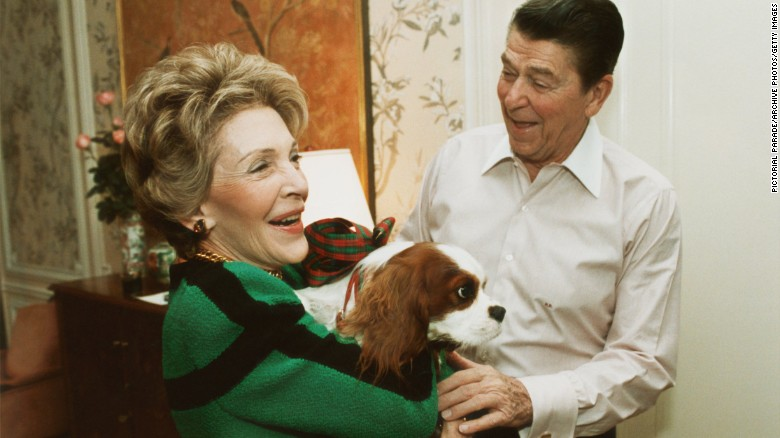 Reagan presents first lady Nancy Reagan with Rex at their suite in a New York City hotel on December 6, 1985.