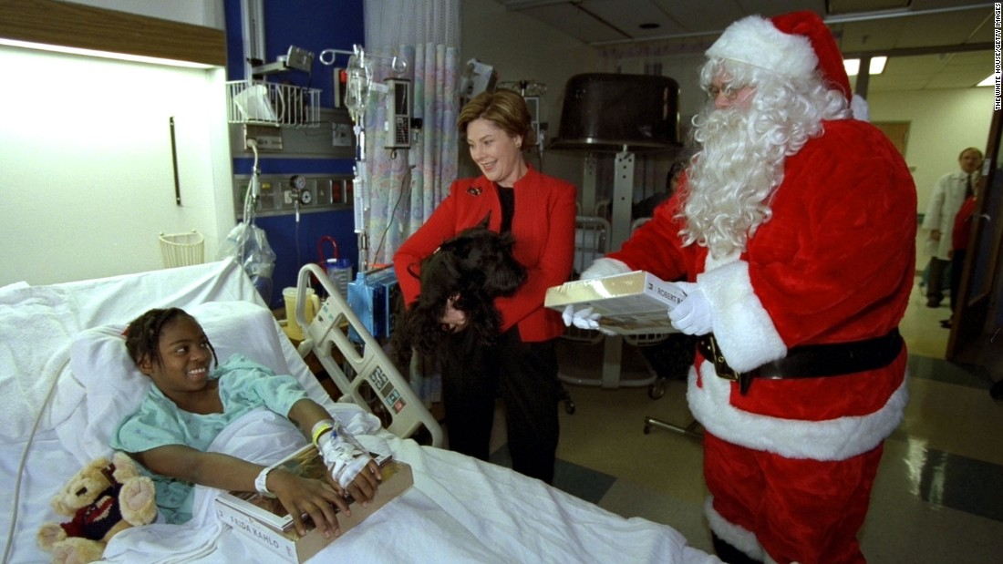 First lady Laura Bush, her Scottish terrier, Barney, and Santa Claus visit Brittanie Morris at the Children's National Medical Center on December 12, 2002, in Washington.