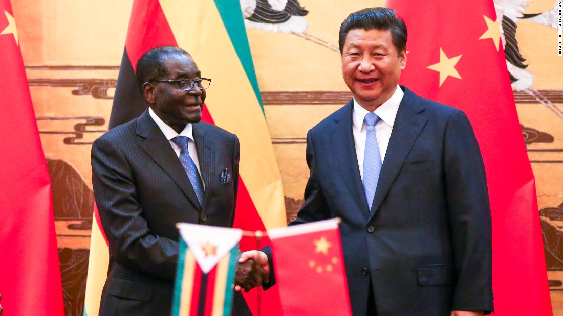 Mugabe and Chinese President Xi Jinping participate in a signing ceremony at the Great Hall of the People in Beijing in 2014.