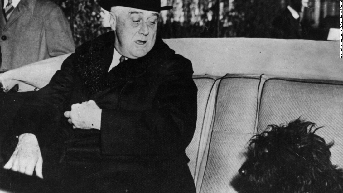 President Franklin Delano Roosevelt sits in his car with his Scottish terrier, Fala, on February 7, 1941.
