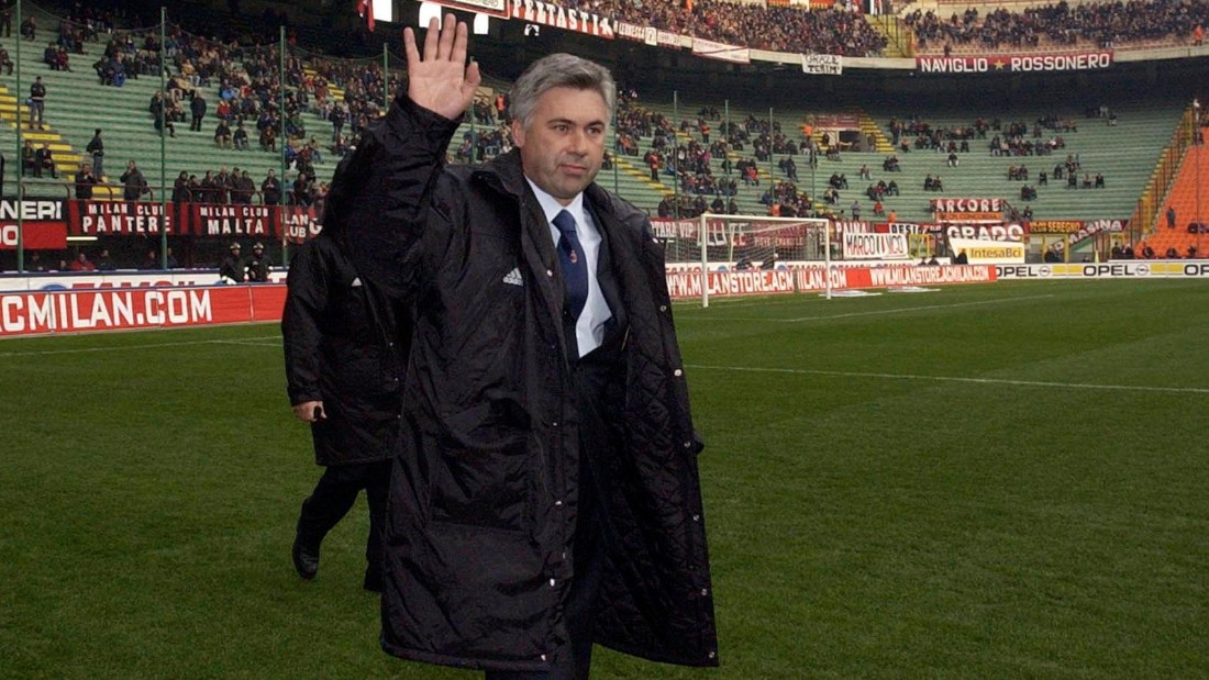 Ancelotti acknowledges the crowd as he walks out for his first match as AC Milan manager in 2001, the first of his 423 games in charge of the club.