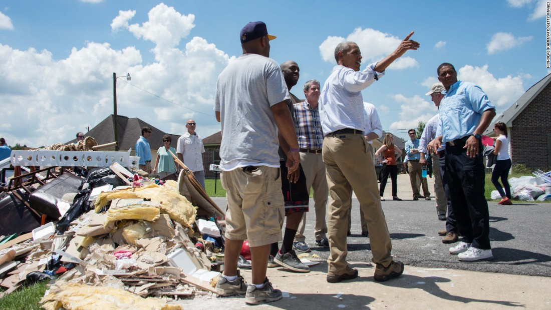 """U.S. President Barack Obama speaks with residents as he <a href=""""http://www.cnn.com/2016/08/23/politics/obama-louisiana-tour-criticism/"""" target=""""_blank"""">tours a flood-affected area</a> in Baton Rouge, Louisiana, on Tuesday, August 23. <a href=""""http://www.cnn.com/2016/08/18/us/louisiana-flooding/"""" target=""""_blank"""">The Red Cross said</a> the catastrophic flooding is the worst to hit the United States since Hurricane Sandy four years ago."""