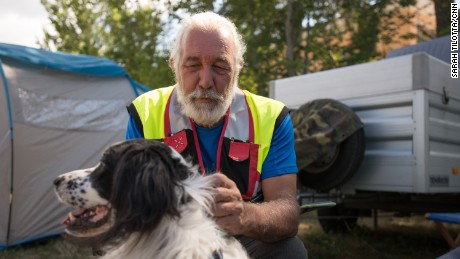 Arturo Filippi pets rescue dog Sam Sam at a volunteer camp in Amatrice. Fillipi, who lives in Venice, is a logistics coordinator with16 years experience in disaster response, including this earthquake and two others.