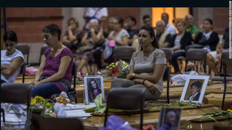 Relatives and friends attend a night vigil in Ascoli Piceno, Italy, ahead of Saturday's funeral.