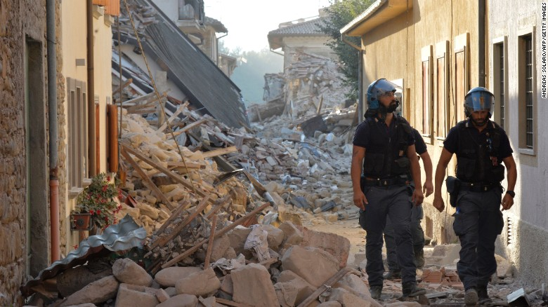 Police inspect the rubble and debris in Amatrice, Italy, on Saturday, August 27. A 6.2-magnitude earthquake struck central Italy on Wednesday, August 24. Hundreds of people have been killed, and the death toll is expected to rise as rescue teams reach remote areas.