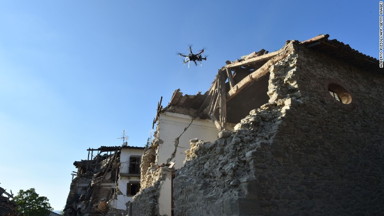 A drone controlled by Italian firefighters flies over damaged houses in San Lorenzo, Italy, on August 27.