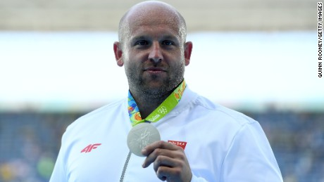 RIO DE JANEIRO, BRAZIL - AUGUST 13:  Silver medalist Piotr Malachowski of Poland celebrates on the podium during the medal ceremony for the Men's Discus Throw Final on Day 8 of the Rio 2016 Olympic Games at the Olympic Stadium on August 13, 2016 in Rio de Janeiro, Brazil.  (Photo by Quinn Rooney/Getty Images)