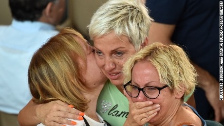 Mourners grieve at Italy's state funeral for earthquake victims.