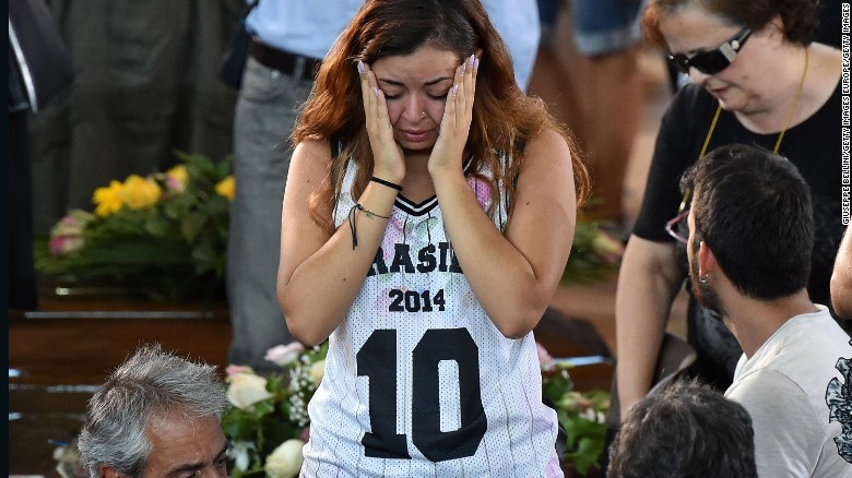 Some of the mourners at a state funeral for Italy's earthquake victims were clearly in shock as they said goodbye to victims.