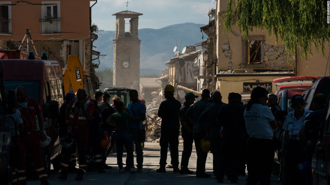 Emergency crews huddle near the iconic Amatrice clock tower still standing amid the rubble. The frozen hands of the clock rest at the time of the earthquake: 3:36 a.m. local time.