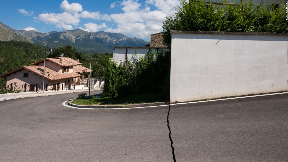 A neat fracture line in the pavement is a telling sign of the earth's violent movement below the streets of Amatrice.
