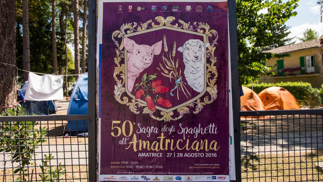 A poster for the 50th anniversary of Amatrice's famous pasta festival, set to take place the weekend following the earthquake, remains on the perimeter of a park now occupied by emergency response volunteers.