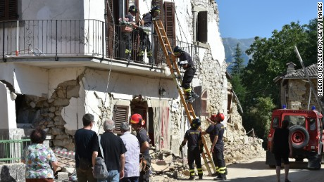 Firefighters help residents to recover their personal belongings from damaged houses in the village of Rio, some 10 kms from the central Italian village of Amatrice, on August 28, 2016, four days after a 6.2-magnitude earthquake struck the region, killing nearly 300 people. Shoddy, price-cutting renovations, in breach of local building regulations, could be partly to blame for the high death toll from this week's devastating earthquake in central Italy, according to a prosecutor investigating the disaster. As questions mount over the deaths of nearly 300 people, prosecutor Giuseppe Saieva indicated that property owners who commissioned suspected sub-standard work could be held responsible for contributing to the quake's deadly impact. / AFP / ALBERTO PIZZOLI        (Photo credit should read ALBERTO PIZZOLI/AFP/Getty Images)