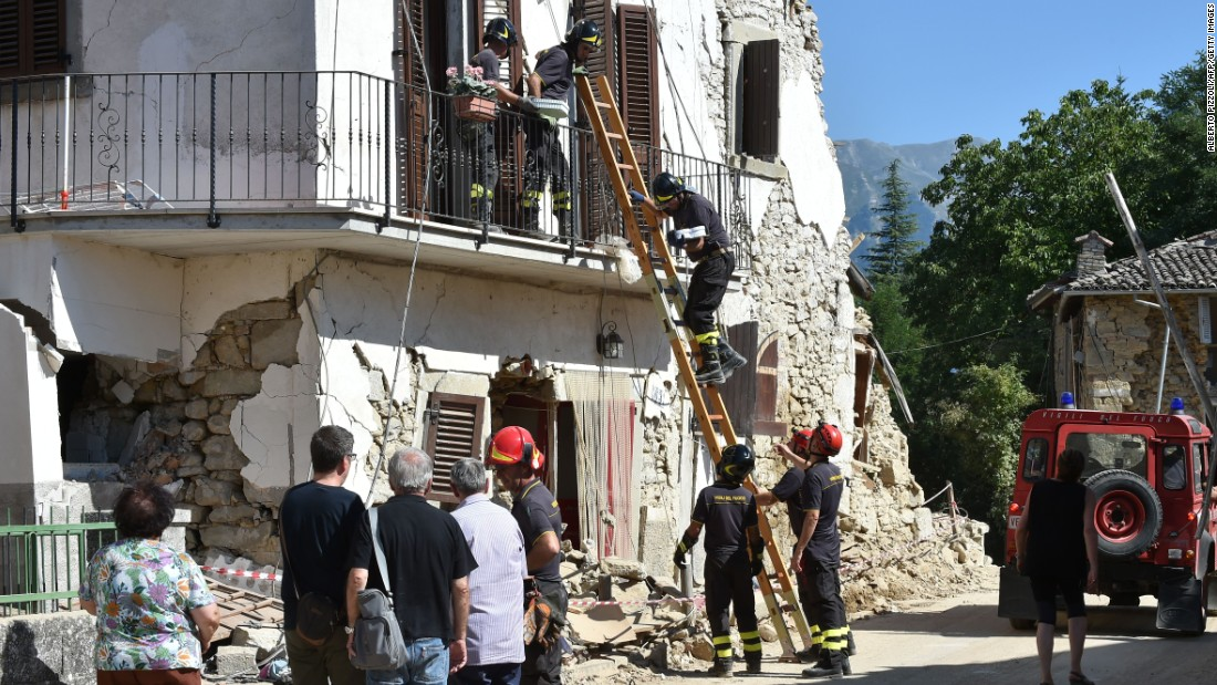 Firefighters help residents recover personal belongings from damaged houses in the village of Rio, Italy, on Sunday, August 28.  A 6.2-magnitude earthquake struck central Italy on Wednesday, killing more than 290 people. The death toll is expected to rise as rescue teams reach remote areas.