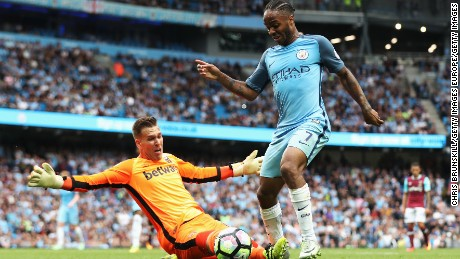 MANCHESTER, ENGLAND - AUGUST 28: Raheem Sterling of Manchester City rounds goalkeeper Adrian of West Ham United to score his second goal and his team's third during the Premier League match between Manchester City and West Ham United at Etihad Stadium on August 28, 2016 in Manchester, England.  (Photo by Chris Brunskill/Getty Images)