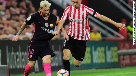 Barcelona's Argentinian forward Lionel Messi (L) vies with Athletic Bilbao's French defender Aymeric Laporte during the Spanish league football match Athletic Club Bilbao vs FC Barcelona at the San Mames stadium in Bilbao on August 28, 2016. / AFP / ANDER GILLENEA        (Photo credit should read ANDER GILLENEA/AFP/Getty Images)