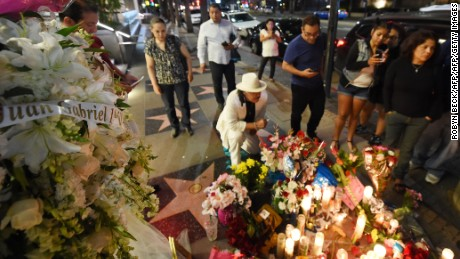 People gather at the Hollywood Walk of Fame star of legendary Mexican singer and producer Juan Gabriel who died at the age of 66 after a heart attack in Santa Monica, California, on August 29, 2016. Legendary Mexican singer and producer Juan Gabriel died after a heart attack in Santa Monica, the Televisa network reported in his home country. He was 66. / AFP / Robyn BECK        (Photo credit should read ROBYN BECK/AFP/Getty Images)