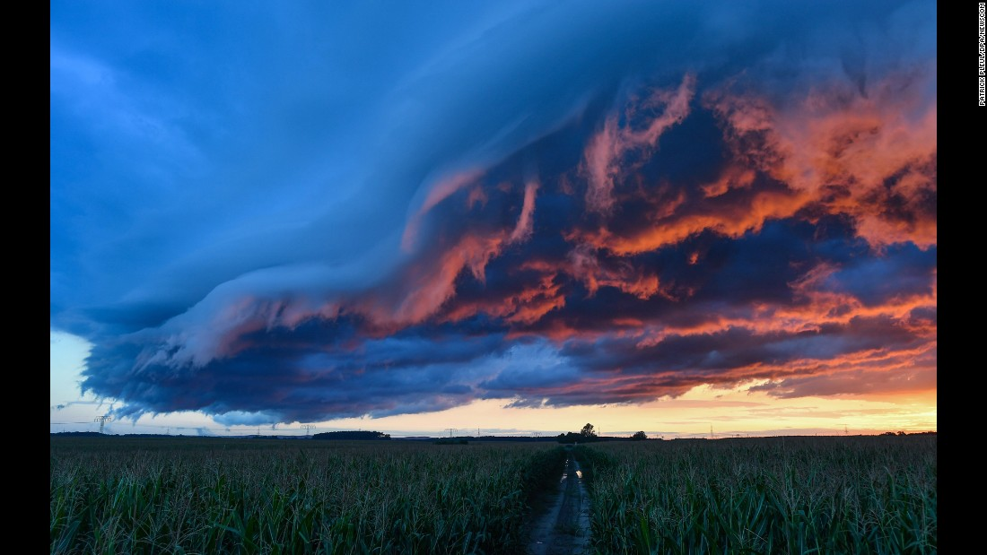 Clouds roll over a cornfield near Petersdorf, Germany, on Sunday, August 21.