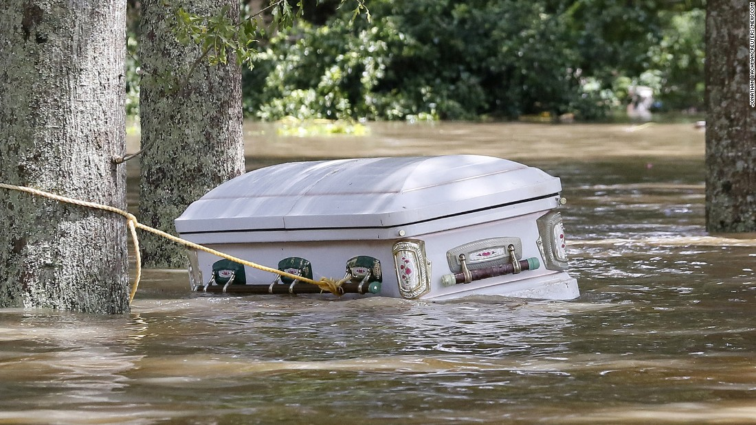 """A casket floats in floodwaters in Ascension Parish, Louisiana, on Monday, August 15. More than 30,000 people were rescued in southern Louisiana after <a href=""""http://www.cnn.com/2016/08/13/us/gallery/louisiana-flooding/index.html"""" target=""""_blank"""">heavy rains caused flooding.</a>"""