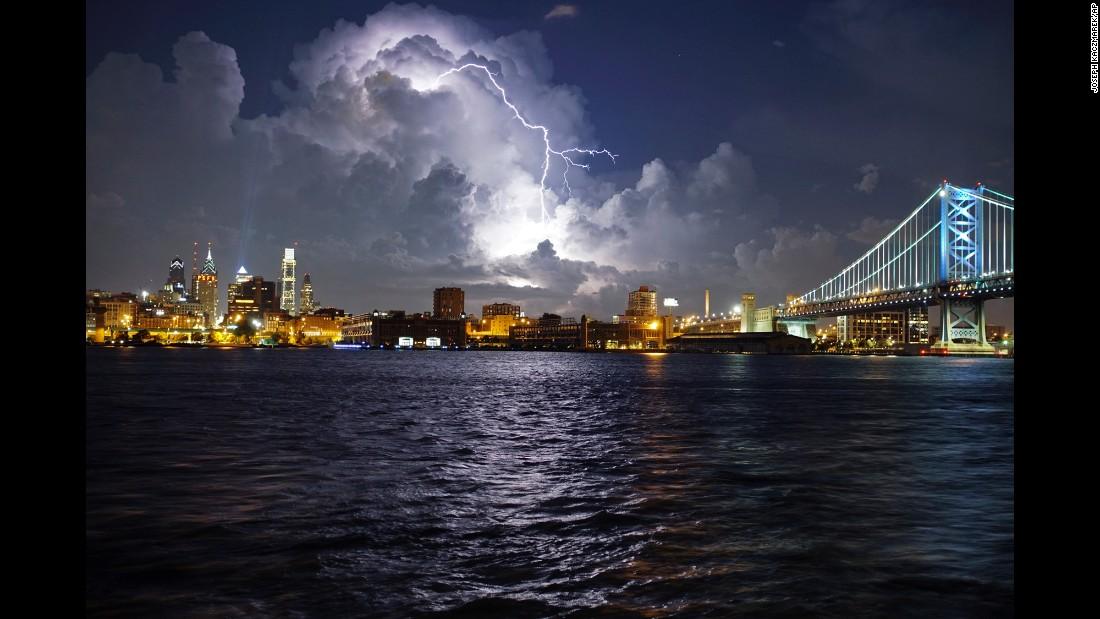 Lightning illuminates storm clouds over the Philadelphia skyline on Tuesday, August 16.