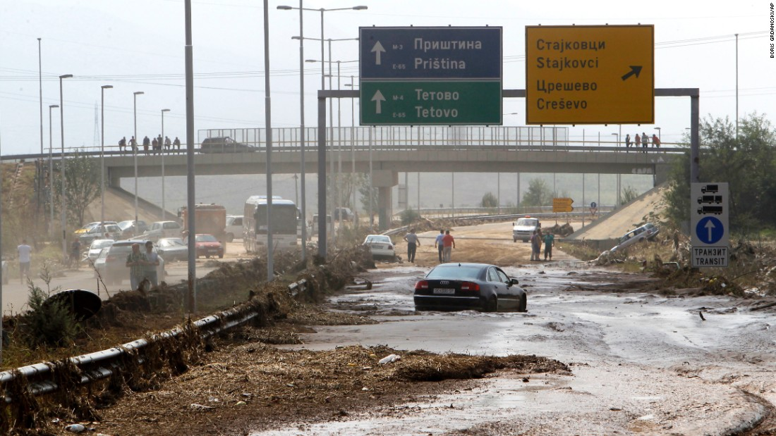 """Abandoned vehicles are seen Sunday, August 7, after an overnight storm <a href=""""http://www.cnn.com/2016/08/07/europe/macedonia-storms/"""" target=""""_blank"""">caused flooding</a> near the Macedonian village of Stajkovci."""