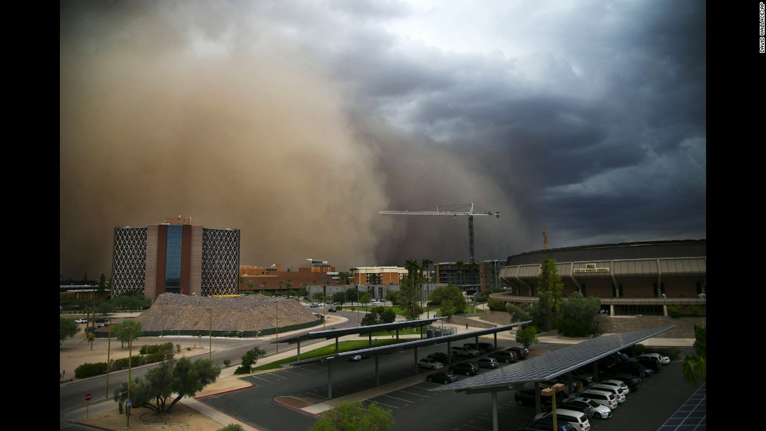 A dust storm moves towards Wells Fargo Arena in Tempe, Arizona, on Tuesday, August 9.