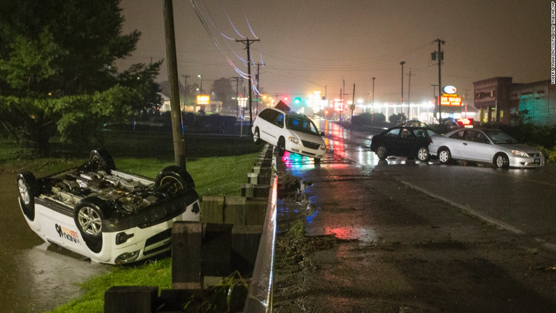 Scattered cars remain after floodwaters subsided in South Bend, Indiana, on Tuesday, August 16.