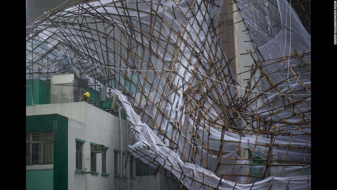 """Rescue workers attempt to secure bamboo scaffolding that was damaged during a storm in Hong Kong on Tuesday, August 2. <a href=""""http://www.cnn.com/2016/08/01/asia/typhoon-nida-hong-kong-guangzhou/"""" target=""""_blank"""">Typhoon Nida</a> hit the city and moved onto mainland China."""