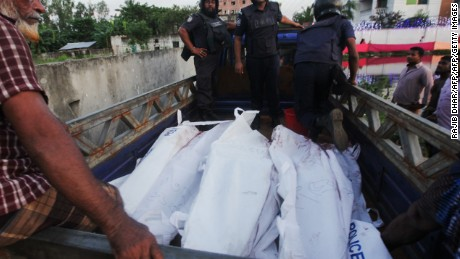 Bangladesh policemen escort the bodies of suspected militants following an operation to storm a militant hideout in Narayanganj, some 25 kms south of Dhaka on August 27, 2016. Bangladesh police stormed a militant hideout outside Dhaka August 27, shooting dead three Islamist extremists, including the suspected mastermind of a horrific attack on a cafe that killed 22 mostly foreign hostages last month. The three bodies were retrieved after police staged an hour-long gun battle with extremists in Narayanganj, a city 25 kilometres (16 miles) south of Dhaka, officers said. / AFP / Rajib Dhar        (Photo credit should read RAJIB DHAR/AFP/Getty Images)