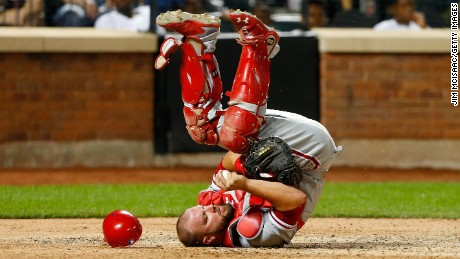 NEW YORK, NY - AUGUST 26:  Cameron Rupp #29 of the Philadelphia Phillies flips over and holds onto the ball after a collision at the plate during the sixth inning against the New York Mets at Citi Field on August 26, 2016 in the Flushing neighborhood of the Queens borough of New York City.  (Photo by Jim McIsaac/Getty Images)